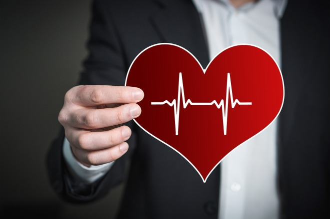 Man holding out heart with pulse