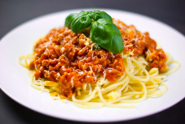 Spaghetti pasta with sauce and leaf